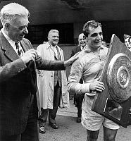 0153311 © Granger - Historical Picture ArchiveMARQUESUZAA.   Marquesuzaa holding the trophy won may 25, 1959 after french rugby championship finale in Bordeaux. Full credit: AGIP - Rue des Archives / Granger, NYC -- All rights