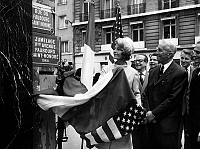 0153550 © Granger - Historical Picture ArchiveMAURICE CHEVALIER.   The Faubourg St Honore street in Paris is twined with the 5th avenue in New York : here Mrs Herve Alphand (wife of the french amabassador in Washington) unveiling the plate with Maurice Chevalier may 18, 1965. Full credit: AGIP - Rue des Archives / Granger, NYC -- All rights res