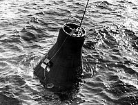 0153846 © Granger - Historical Picture ArchiveMERCURY ATLAS 6: CAPSULE FRIENDSHIP 7.   Astronaut John Glenn aboard Friendship VII, recovered off the Bahamas, february 1962 (Mercury project). Full credit: AGIP - Rue des Archives / Granger, NYC -- All rights reserved.