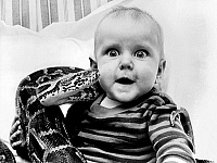 0155707 © Granger - Historical Picture ArchiveBABY AND PYTHON, 1985.   Baby Stephanie, growing up in a circus, knows how to behave with Monty the Python, offered as a pet by her father, owner of a travelling circus. Photograph, 22 November 1985. Full credit: AGIP - Rue des Archives / Granger, NYC -- All Rights Reserved.