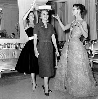0156403 © Granger - Historical Picture ArchiveOLIVIA OF HAVILLAND AND LUCKY.   In Dior room Olivia De Havilland is learning to be a model with Victoire and Lucie Daouphars, called Lucky, october 28, 1955 because she is shooting in Paris a movie. Full credit: AGIP - Rue des Archives / Granger, NYC -- All Rights Reserved.