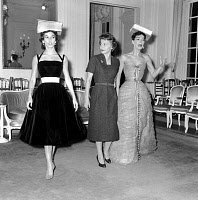 0156404 © Granger - Historical Picture ArchiveOLIVIA OF HAVILLAND AND LUCKY.   In Dior room Olivia De Havilland is learning to be a model with Victoire and Lucie Daouphars, called Lucky, october 28, 1955 because she is shooting in Paris a movie. Full credit: AGIP - Rue des Archives / Granger, NYC -- All Rights Reserved.