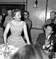 0156405 © Granger - Historical Picture ArchiveOLIVIA OF HAVILLAND AND ROBERT FAVRE THE BRET.   Olivia de Havilland and Robert Favre Le Bret festival's directory in restaurant during Cannes film festival april 27, 1955. Full credit: AGIP - Rue des Archives / Granger, NYC -- All rights r