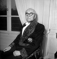 0156919 © Granger - Historical Picture ArchivePAUL CLAUDEL.   French writer Paul Claudel (1868-1955) wearing suit of Academie Francaise, here at home on march 10, 1947 before his investiture. Full credit: AGIP - Rue des Archives / Granger, NYC -- All rights reserved.