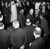 0157005 © Granger - Historical Picture ArchivePAUL MINOT AND DIORI HAMANI.   Reception given in Paris city hall on september 28, 1961 for visit of president of Niger Diori Hamani and his wife : Paul Minot, president of town council. Full credit: AGIP - Rue des Archives / Granger, NYC -- All Rights Reserved.