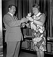 0157084 © Granger - Historical Picture ArchivePAULE HERREMAN AND FIRMIN BOUGLIONE.   Paule Herreman (radio presenter) receiving a prize from Firmin Bouglione october 9, 1972. Full credit: AGIP - Rue des Archives / Granger, NYC -- All Rights Reserved.