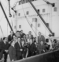0157097 © Granger - Historical Picture ArchivePAUL EMILE VICTOR AND SON EQUIPE.   departure in the Havre of french polar expedition on danish cargo Thala Dan for Adelie land. Here french explorer Paul Emile Victor and his team on october 12, 1963. Full credit: AGIP - Rue des Archives / Granger, NYC -- All rights reserved.