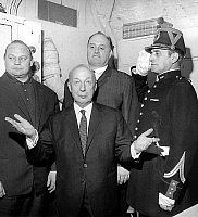 0157550 © Granger - Historical Picture ArchivePIERRE DAC.   French writer Pierre Dac (1893-1975) with Andre Bollet , Franck Valois and a Republican Guard for press conference february 10, 1965 during which he announced the creation of Unified Ondulatory Movement party and his candidacy to presidential elections. Full credit: AGIP - Rue des Archives / Granger, NYC -- All rights reserved.