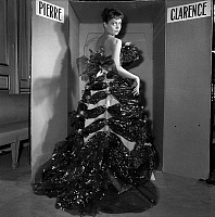 0157887 © Granger - Historical Picture ArchivePIERRETTE BRUNO.   Pierrette Bruno wearing a dress by Pierre Clarence made with hessian, kitchen foil, gift ribbon, october 28, 1953. Full credit: AGIP - Rue des Archives / Granger, NYC -- All Rights Reserved.