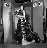 0157888 © Granger - Historical Picture ArchivePIERRETTE BRUNO.   Pierrette Bruno wearing a dress by Pierre Clarence made with hessian, kitchen foil, gift ribbon, october 28, 1953. Full credit: AGIP - Rue des Archives / Granger, NYC -- All Rights Reserved.