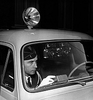 0158137 © Granger - Historical Picture ArchivePREVENTION ROUTIERE.   A policeman on patrol in a 403 car with cameras and an electronic flash set off by a button : the policeman can record the offences he sees, march 22, 1957. Full credit: AGIP - Rue des Archives / Granger, NYC -- All Rights Reserved.