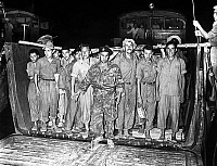 0158219 © Granger - Historical Picture ArchivePRISONNIERS FRANCAIS.   350 french prisoner soldiers liberated by vietnamese popular army and greeted by general Masson august 05, 1954. Full credit: AGIP - Rue des Archives / Granger, NYC -- All Rights Reserved.