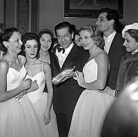 0160443 © Granger - Historical Picture ArchiveSERGE LIFAR.   Serge Lifar after he received the golden ballet shoe with dancers Josette Amiel, Francine Collement, Nina Vyroubova, Micheline Grimoin, Liane Dayde december 28, 1955. Full credit: AGIP - Rue des Archives / Granger, NYC -- All Rights Reserved.