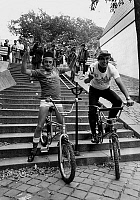 0160588 © Granger - Historical Picture ArchiveSIM AND JEAN PIERRE FOUCAULT.   Sim and Jean-Pierre Foucault riding in stairs in Montmartre, Paris, september 23, 1982. Full credit: AGIP - Rue des Archives / Granger, NYC -- All Rights Reserved.