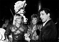 0160947 © Granger - Historical Picture ArchiveSTEPHANE FERRARA.   Former boxer Stephane Ferrara declared the sexiest man of the year congratulated by Lova Moor (l Marie Claude Jourdain) and journlaist France Roche during tvprogram Sexy folies at Intercontinental hotel in Paris on paril 24, 1986. Full credit: AGIP - Rue des Archives / Granger, NYC -- All Rights Reserved.