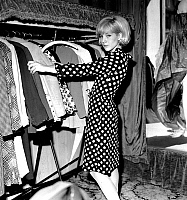 0161099 © Granger - Historical Picture ArchiveSYLVIE VARTAN.   Sylvie Vartan during dress fitting at the shop of fashion-designer Real for film Patate, april 27, 1964. Full credit: AGIP - Rue des Archives / Granger, NYC -- All Rights Reserved.