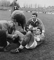 0161528 © Granger - Historical Picture ArchiveTOURNOI OF CINQ NATIONS 1955.   The french rugby player Domec is wounded during the final of Rugby, of the Five Nations tournament between France and Wales, winner 16 to 11, in the stadium of Colombes, on March 26th, 1955. Full credit: AGIP - Rue des Archives / Granger, NYC -- All rights reserved.