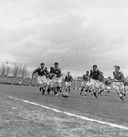 0161529 © Granger - Historical Picture ArchiveTOURNOI OF CINQ NATIONS 1955.   The final of Rugby, of the Five Nations tournament between France and Wales, winner 16 to 11 : l-r Brejassou (3), Baulon, Meredith and Gallois, in the stadium of Colombes, on March 26th, 1955. Full credit: AGIP - Rue des Archives / Granger, NYC -- All rights reserved.