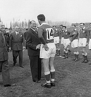 0161532 © Granger - Historical Picture ArchiveTOURNOI OF CINQ NATIONS 1955.   The president of the french republic Rene Coty congratulates the welsh players during the final of Rugby, of the Five Nations tournament between France and Wales, winner 16 to 11, in the stadium of Colombes, on March 26th, 1955. Full credit: AGIP - Rue des Archives / Granger, NYC -- All rights reserved.
