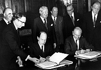 0161610 © Granger - Historical Picture ArchiveTUNNEL SOUS THE MANCHE.   French president Georges Pompidou (rear left) with French Minister of Foreign Affairs Michel Jobert (seated left) and Britsh Foreign Secretary Sir Alec Douglas-Home (seated right) signing the treaty for the building of the tunnel under the Channel, 20 November 1973. Full credit: AGIP - Rue des Archives / Granger, NYC -- All rights r