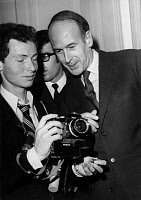 0161803 © Granger - Historical Picture ArchiveVALERY GISCARD D'ESTAING.   (1926- ). French President (1974-1981). Photographed while French Minister of Finance, taking interest in a photographer's camera before a meeting with the French President Georges Pompidou in Paris, France, 3 June 1969. Full credit: AGIP - Rue des Archives / Granger, NYC -- All Rights Reserved.