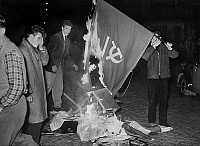 0162026 © Granger - Historical Picture ArchiveVIOLENTES MANIFESTATIONS ANTI COMMUNISTES A VIENNE.   Demonstration against communism in Austria (Vienne). Here, a student throwing the communist flag on the bonfire, Vienne, 1956. Full credit: AGIP - Rue des Archives / Granger, NYC -- All Rights Reserved.