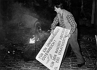 0162027 © Granger - Historical Picture ArchiveVIOLENTES MANIFESTATIONS ANTI COMMUNISTES A VIENNE..   Demonstration against communism in Austria (Vienne). Here, a student throwing a communist placard on the bonfire, Vienne, 1956. Full credit: AGIP - Rue des Archives / Granger, NYC -- All Rights Reserved.