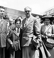 0162401 © Granger - Historical Picture ArchiveYVES FARGE.   Yves Farge french minister of supplies coming back from Bikini Atoll with his wife and his son here july 08, 1946 (where american government made some atomic tests). Full credit: AGIP - Rue des Archives / Granger, NYC -- All Rights Reserved.