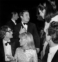 0162527 © Granger - Historical Picture ArchiveYVES SAINT LAURENT, MME WEISWEILLER AND IRA FURSTENBERG.   Yves Saint-Laurent, Mrs Weisweiller and Ira Furstenberg (standing) at gala of Lido in Paris december 21, 1966. Full credit: AGIP - Rue des Archives / Granger, NYC -- All rights rese