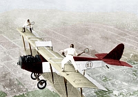 0163107 © Granger - Historical Picture ArchiveAIRPLANE TENNIS, 1925.   Ivan Unger and Gladys Roy playing tennis on the wings of a biplane in flight. Hand-colored photograph, 1925.