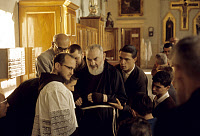 0163459 © Granger - Historical Picture ArchiveSAINT PIO OF PIETRELCINA   (1887-1968). Born Francesco Forgione. Italian Capuchin priest and missionary, canonized by the Catholic Church in 2002. Photographed with other clergymen inside a church, 1963.