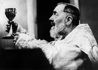 0163461 © Granger - Historical Picture ArchiveSAINT PIO OF PIETRELCINA   (1887-1968). Born Francesco Forgione. Italian Capuchin priest and missionary, canonized by the Catholic Church in 2002. Photographed giving mass, 4 July 1959.