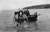 0173947 © Granger - Historical Picture ArchivePOSTCARD: MORGAT, BRITTANY.   Disembarking from a rowboat. Morgat, Brittany, France. Postcard, c1906. Full credit: Bourgeron - Rue des Archives / Granger, NYC -- All rights reserve