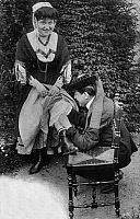 0173963 © Granger - Historical Picture ArchivePOSTCARD: COUPLE.   A man looking for a flea on the leg of a woman, Brittany, France. Postcard, c1900-1910. Full credit: Bourgeron - Rue des Archives / Granger, NYC -- All rights r