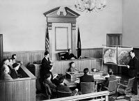 0174229 © Granger - Historical Picture ArchiveCOURTROOM EVIDENCE, 1950s.   An F.B.I. scientist testifying to a jury during a criminal trial in an American courtroom in the 1950s about his findings concerning a heel print obtained as evidence (the photograph shows a reenactment, as cameras were barred from the courtroom during the actual trial).