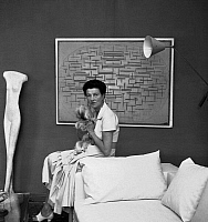 0175308 © Granger - Historical Picture ArchivePEGGY GUGGENHEIM  (1898-1979). American art collector. Photographed in front of the painting 'Ocean 5' by Piet Mondrian, 1957.