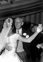 0184355 © Granger - Historical Picture ArchiveKENNEDY WEDDING, 1953.   Joseph Kennedy dancing with daugher-in-law Jacqueline Bouvier Kennedy at her wedding to John F. Kennedy in Newport, Rhode Island. Photograph, 12 September, 1953.