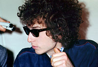 0216422 © Granger - Historical Picture ArchiveBOB DYLAN (1941- ).   American musician. Photographed at a press conference in Paris before his concert at the Olympia, 23 May 1966. Full credit: Fititjian - Rue des Archives / Granger, NYC -- All Rights Reserved.