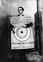0259979 © Granger - Historical Picture ArchiveANDRÉ BRETON (1896-1966).   French poet, essayist, and critic. Photographed wearing a sandwich board by Francis Picabia at a Dada festival in Paris, France, 27 March 1920. Full credit: PVDE - Rue des Archives / Granger, NYC -- All rights re