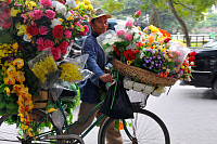 0266406 © Granger - Historical Picture ArchiveVIETNAM: STREET VENDOR.   A flower vendor in Hanoi, Vietnam. Photograph by Marc Charuel, 2009. Full credit: