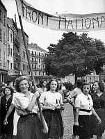 0268513 © Granger - Historical Picture ArchiveLIBERATION: TOULOUSE, 1944.   Women of the National Front carrying a banner in celebration of the liberation of Toulouse, France. Photograph, 21 August 1944. Full credit: Jean Dieuzaide - Rue des Archives / Granger, NYC -- All rights reserv