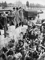 0072353 © Granger - Historical Picture ArchiveBERLIN AIRLIFT, 1948.   Alderman Paul Follsack distributing newly-arrived fresh fruit delivered by the Berlin Airlift to blockaded Berliners. Photograph, 1948.