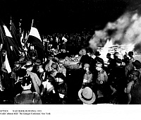 0072820 © Granger - Historical Picture ArchiveNAZI BOOK BURNING, 1933.   Burning pyre of books on the square at the Staatsoper Unter den Linden (opera house) in Berlin. In the foreground are members of the SA and SS, 05.10.1933.