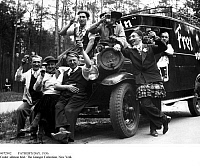 0072902 © Granger - Historical Picture ArchiveFATHER'S DAY, 1936.  Men dressed-up for a tour on Father's Day (Ascension Day). They are sitting on a car with the inscription 'Free from mom' and raising their beer glasses, 1936.
