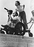 0073082 © Granger - Historical Picture ArchiveLENI RIEFENSTAHL   (1902-2003). German photographer, director and actress. Riefenstahl with cameraman Walter Frentz during the shooting of her two-part Olympic-games movie in Berlin. Part 1 - Festival of Beatuy and Part 2 - Festival of the Nations. Photograph, 1936.