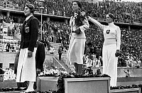 0073186 © Granger - Historical Picture ArchiveGERMANY: OLYMPICS, 1936.   Medal presentation ceremony for women's fencing. From left: Ellen Preiss (Austria, 3rd), Ilona Elek-Schacherer (Hungary, 1st) and Helene Mayer (Germany, 2nd) raising her arm in the Nazi salute. Photograph, August 1936. Full credit: Cooper - ullstein bild / Granger, NYC -- All Rights Reserved
