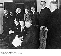0073270 © Granger - Historical Picture ArchiveHITLER & CABINET, 1933.   Adolf Hitler (seated, center) speaking with Vice-Chancellor Franz von Papen during a meeting with his cabinet on the first day of his chancellorship, 30 January 1933. Seated behind Hitler is Nazi party leader Hermann Goering. Sitting, from the front: Vice-Chancellor von Papen, Chancellor Hitler, Goering. Standing: Hugenberg (economy