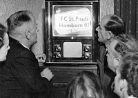 0073360 © Granger - Historical Picture ArchiveGERMANY: TELEVISION, 1952.   Residents of the city of Lippstadt, Germany, watching the first television broadcast in the Federal Republic of Germany (FRG) after 1945, a soccer match between FC St. Pauli and Hamborn 05, broadcast by station NWDR in Langenburg, 28 December 1952.