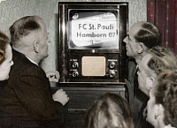 0073361 © Granger - Historical Picture ArchiveGERMANY: TELEVISION, 1952.   Residents of the city of Lippstadt, Germany, watching the first television broadcast in the Federal Republic of Germany (FRG) after 1945, a soccer match between FC St. Pauli and Hamborn 07, broadcast by station NWDR in Langenburg, 28 December 1952. Color photograph.