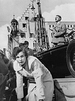 0073409 © Granger - Historical Picture ArchiveTRIUMPH OF THE WILL, 1934.   Leni Riefenstahl directing the filming of German chancellor Adolf Hitler watching members of the Reichsarbeitsdienst (State Labor Service) march through Adolf-Hilter-Platz in Nuremburg, Germany, for her film, 'Triumph of the Will,' on 6 September 1934.